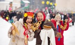 happy women celebrating  Pancake Week at Russia