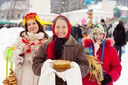 happy women celebrating  Shrovetide  at Russia