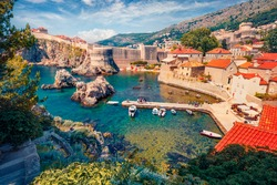 Сharm of the ancient cities of Europe. Aerial mornig view of Old Town from Fort Bokar. Picturesque summer cityscape of Dubrovnik. Sunny seascape of Adriatic sea, Croatia, Europe.