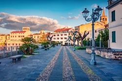 Сharm of the ancient cities of Europe. Splendid morning cityscape of Alghero town, Province of Sassari, Italy, Europe. Amazing spring scene of Sardinia island. Traveling concept background.