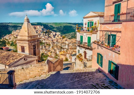 Сharm of the ancient cities of Europe. Sunny spring cityscape of Ragusa town with Church of St Mary of the Stairs on background. Wonderfulmorning scene of Sicily, Italy, Europe.