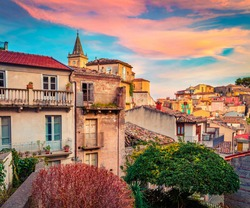 Сharm of the ancient cities of Europe. Wonderful cityscape of Novara di Sicilia town. Colorful spring sunrise in Sicily, Italy, Europe. Beautiful world of Mediterranean countries.