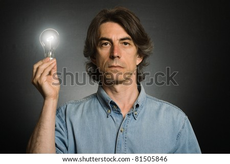 have an idea! Surprised man holding lighting bulb