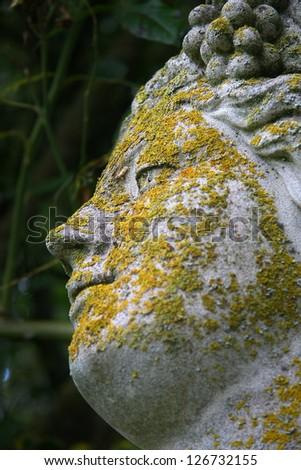 Head sculpture with lichen in Barwick, England