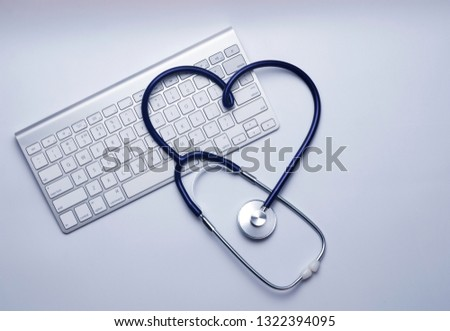 Health care - medical concept for online consultation or cardiologists with tablet pc.  Top view