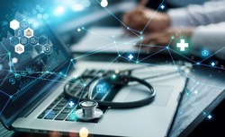 Healthcare business graph data and growth, Insurance Healthcare. Doctor analyzing medical of business report and medical examination with network connection on laptop screen.