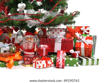 heap of festive gift boxes under decorated Christmas tree