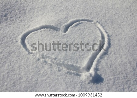 Heart painted on snow #1009931452