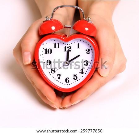 Stock Photo  Heart shape alarm clock