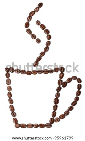Heart shape made from coffee beans with a   cup of coffee