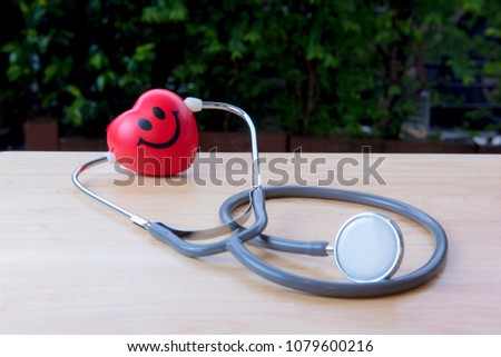 Heart shaped and equipped with a stethoscope attached to the ear #1079600216