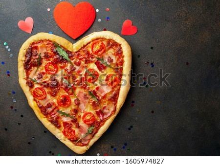 heart-shaped pizza for Valentine's Day on a stone fonya. festive dinner for two for valentines day Stock fotó ©