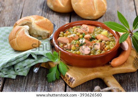 Hearty pea stew with potatoes, bacon and Viennese sausages Stock photo ©