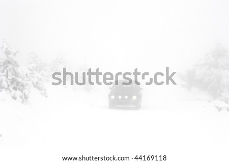 heavy snow on the road in the foggy day