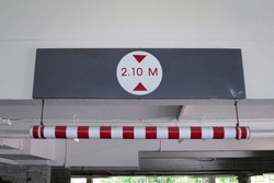 ็Height limit 2.1 metres traffic sign of car park building. Maximum height limit or height restriction traffic sign. Sing and transportation concept.