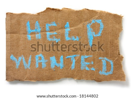 """Help Wanted"" chalked on torn cardboard sign, isolated on white with soft shadow. - stock photo"