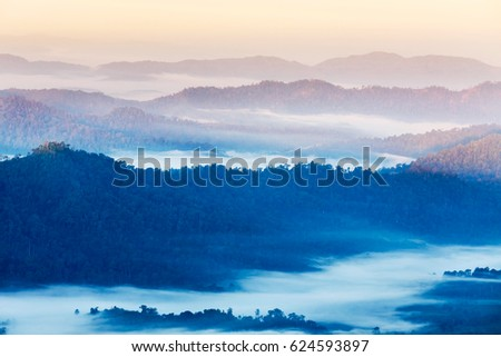 High angle view over tropical mountains layer with white fog in early morning in Thailand. #624593897