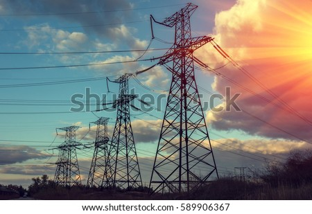 high-voltage  power lines at sunset. electricity distribution station . #589906367