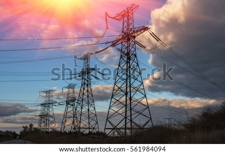 high-voltage  power lines at sunset. electricity distribution station . high voltage electric transmission tower.  #561984094