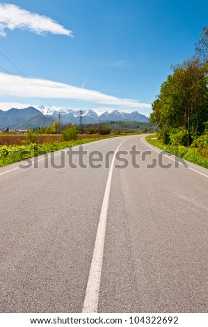 Highway in Piedmont on the Background of Snow-capped Alps, Italy