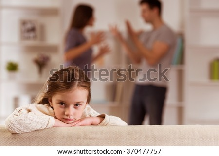 Ð¡hild suffering from quarrels between parents in the family at home