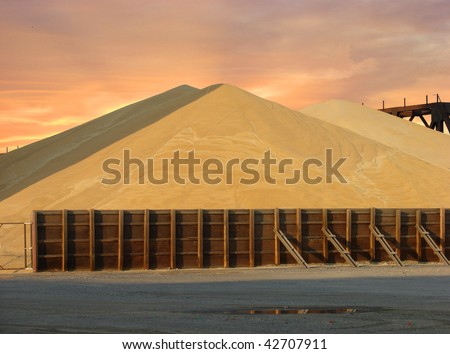 hill of grain with glowing sunset in background