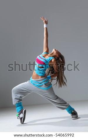 hip-hop style dancer posing on studio background