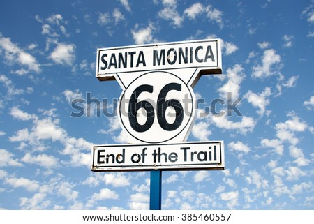 66 historic route sign against cloudy sky background #385460557