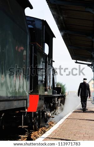 Historical steam train locomotive at station