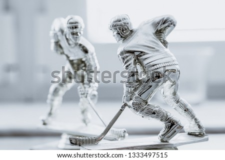 Hockey sculptures as a symbol of ice hockey. Hockey legend, competition, winner concept. Tournament reward #1333497515