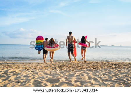 Holiday summer beach party with friends at sea .Party beach family and friends  jumping on the beach. lifestyle people vacation holiday on beach