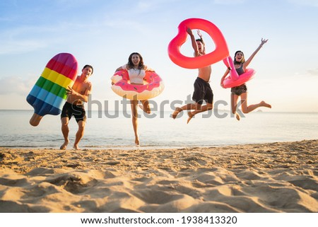 Holiday summer beach party with friends on the beach .Group of family party beach, friends, jumping, lifestyle people vacation holiday on beach
