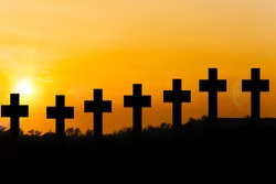 Holy place.  Cemetery concept: cross at sunset.