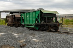 hoppers are loaded with rubble on the railroad