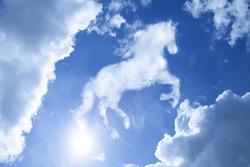 horse shape-like cloudy on bright blue sky metaphor as power