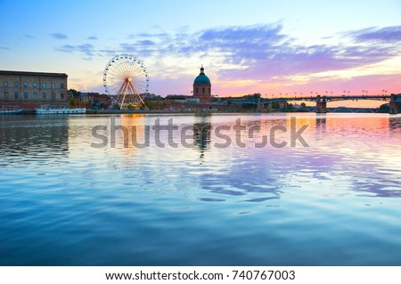 Hospital de La Grave and Ferries Wheel reflected in Garone river. Toulouse, France