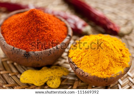 Hot red chili pepper and turmeric in clay bowls