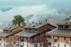 Hotel in the mountains, covered with fog.