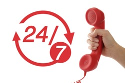 24 hours a day, 7 days a week hotline service. Woman holding handset on white background, closeup