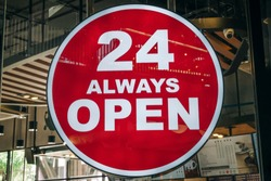 24 Hours Always Open Sign in front of the regular coffee cafe or co-working space in the city new trend of working space