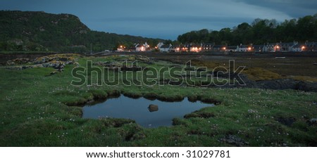 houses at plockton bay in Scotland at low tide - stock photo