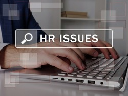 HR ISSUES Human resources text in search line. Modern Banker looking for something at computer. HR ISSUES Human resources concept.