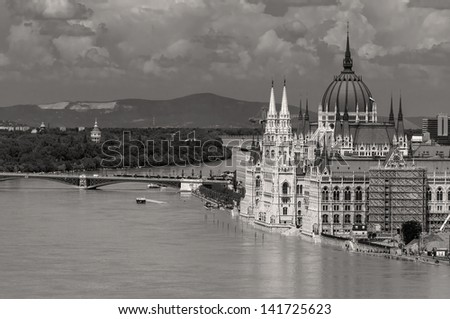 Hungarian parliament with the flooding Danube. Black and white version.