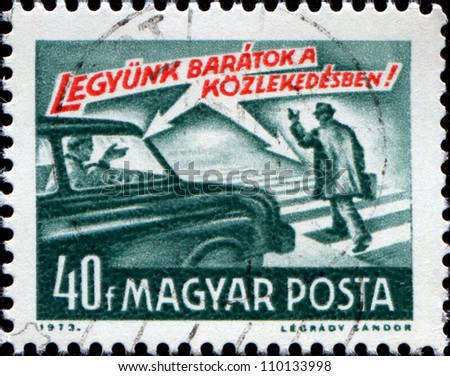 """HUNGARY - CIRCA 1973: A stamp printed in Hungary from the """"Road Safety"""" issue shows car and pedestrian and """"let's be friends !"""" inscription, circa 1973"""