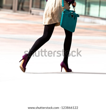 Hurrying business woman. The modern woman.