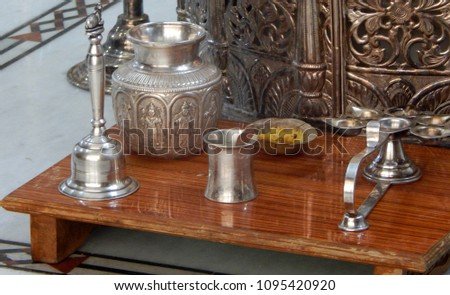 HYDERABAD,INDIA-MAY 8:Closeup of silver items such as bell,pot and deepam or fire stand, a tradition and culture,in a Hindu temple on May 8,2018 in Hyderabad,India                                  #1095420920
