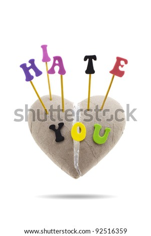 'I Hate You' spelled out with letters on broken heart made of paper, isolated on white background
