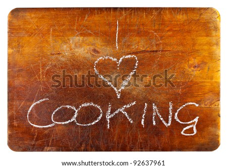 """""""I love cooking"""" text on wooden cutting board isolated on white background"""