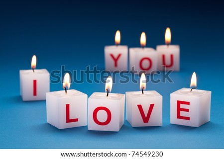 """I love you"" printed on candles."