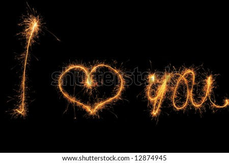 """I love you"" sign made by sparkler"